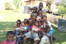 A missionary surrounded by kids in South Africa