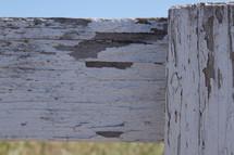 peeling paint on a fence