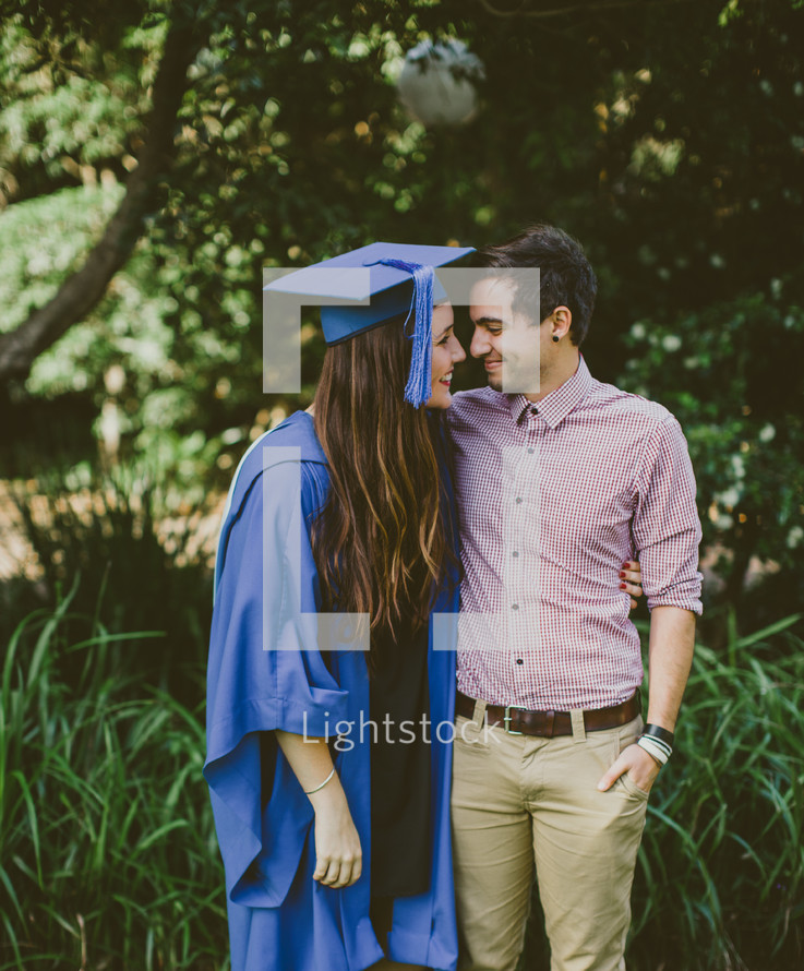 Embraced couple at graduation.ad