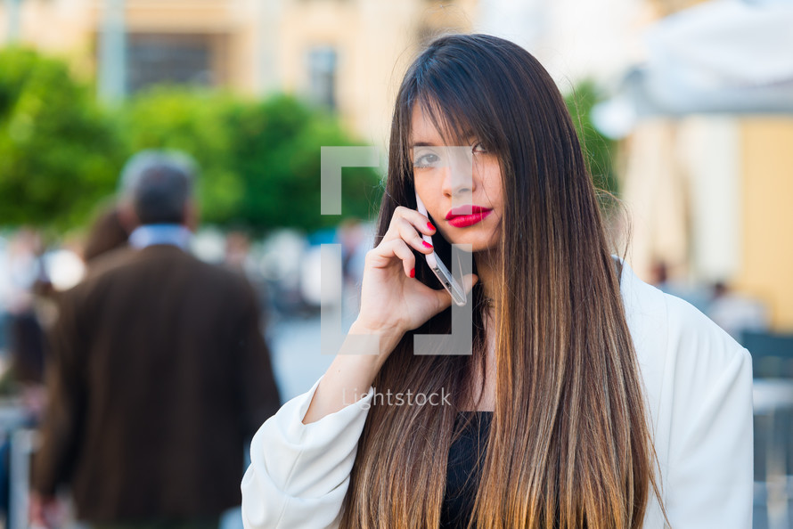 a woman talking on a cellphone