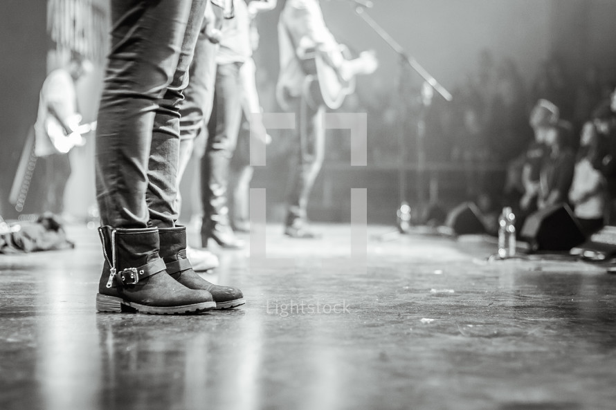 boots on stage at a concert