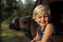 smiling boy on a train