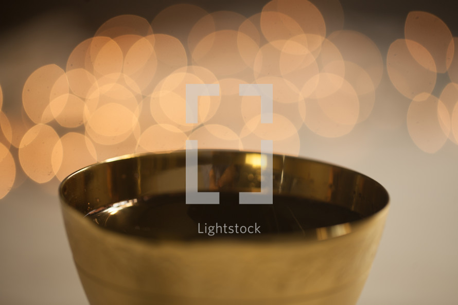 bokeh lights behind a chalice