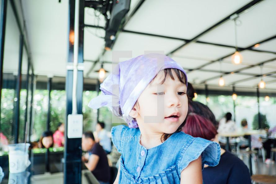 toddler girl wearing a bandana
