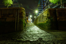 alley in a city at night