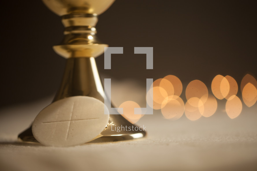 chalice and host with bokeh lights