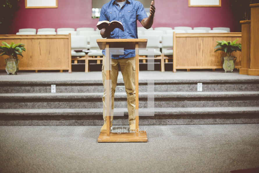 a man reading from a Bible in church
