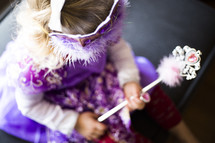 a toddler girl dressed up like a princess