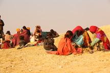 refugees resting in desert sand