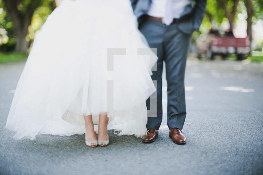 Bride and Groom standing in street