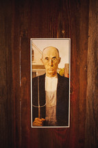 Half of American Gothic painting by Grant Wood; Painting of farmer with pitchfork
