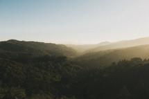 sunlight on rolling hilltops