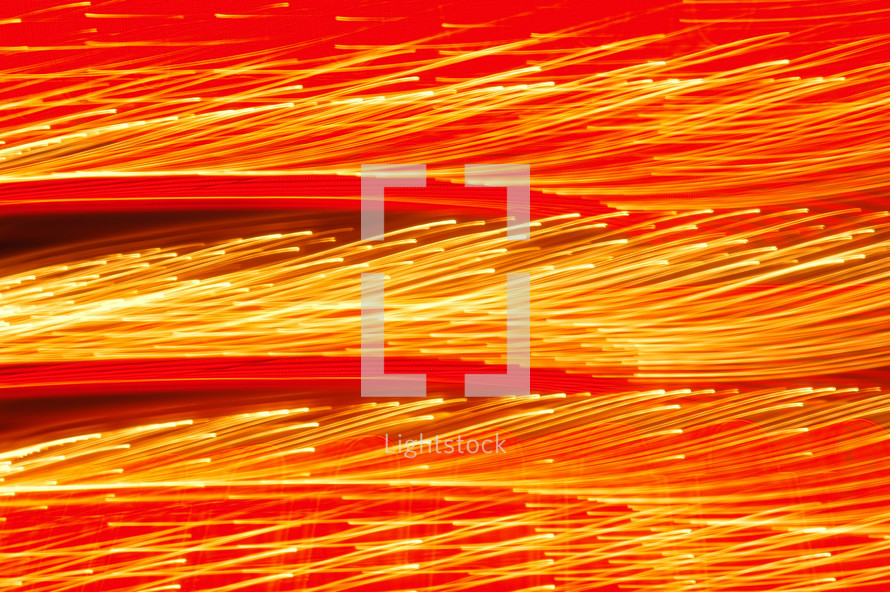 Bright lights forming a dazzling red and yellow pattern. Movement in lights