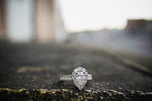 engagement ring on asphalt