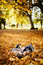 Couple lying in Fall leaves