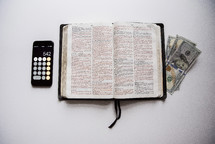 calculator, cash, and Bible
