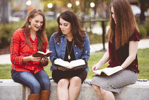 women reading Bibles together outdoors