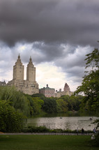 Tall buildings behind a pond in Central Park.