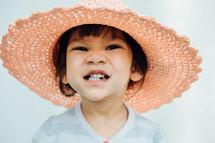 little girl in a sunhat