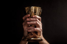 Hands holding a communion goblet.