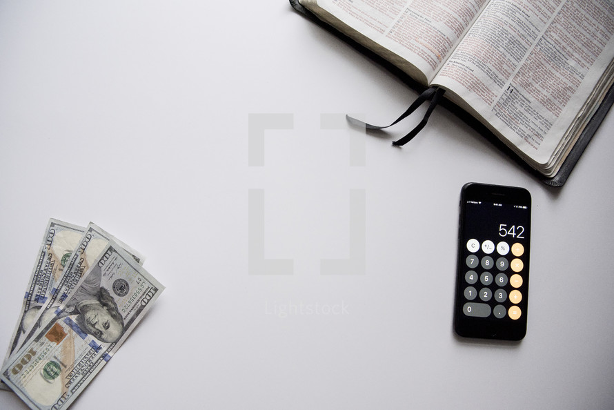 money, calculator app, and opened Bible