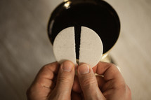 breaking apart a wafer at communion