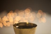chalice and bokeh lights