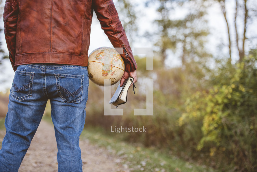 man with a globe and Bible