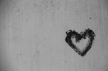 black and white painted heart on textured wall background
