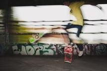 ten boy doing tricks on a skateboard