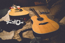 guitars resting on a bed