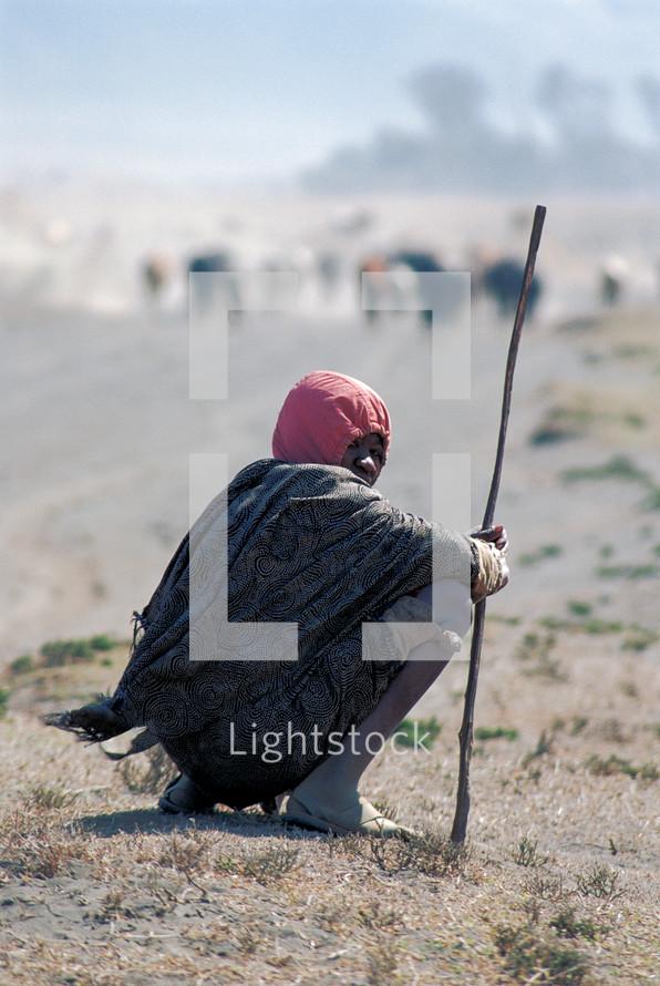 shepherd kneeling to rest