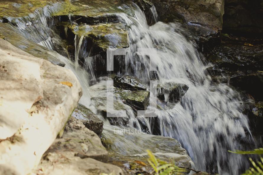 Water rushing over rocks.