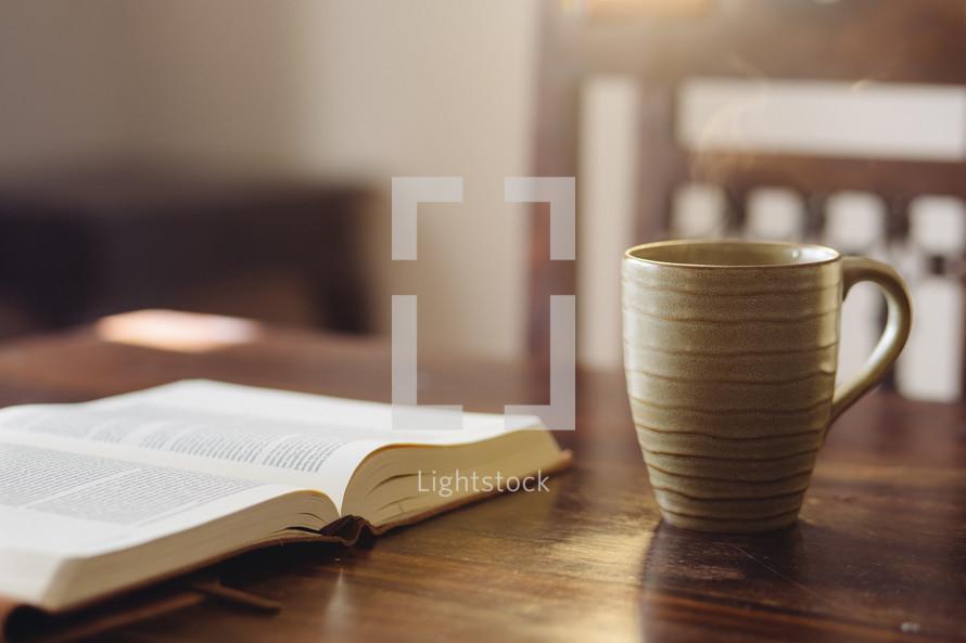 open Bible and a coffee mug