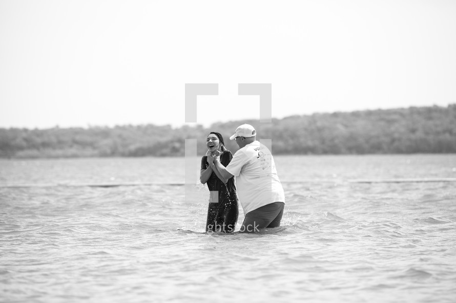 baptism of a woman in a lake