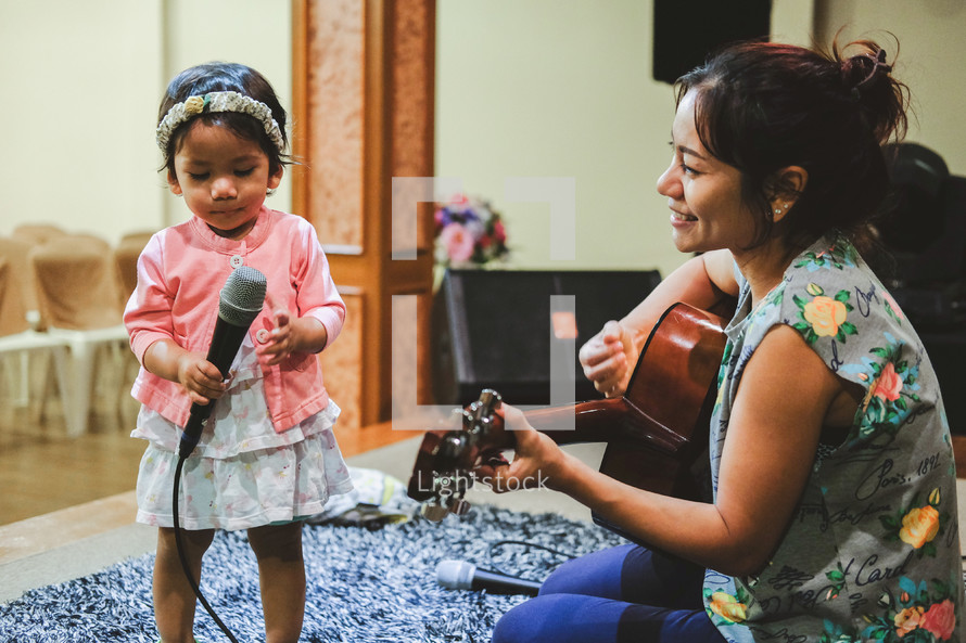 mother and daughter playing music