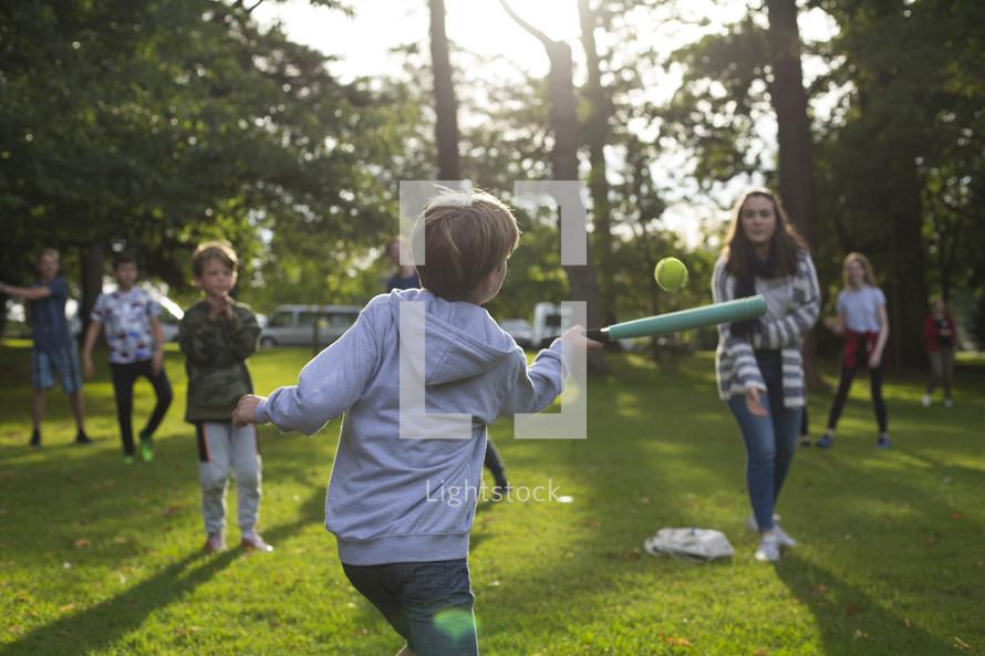 kids playing baseball outdoors