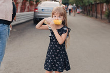girl eating a corn on the cob