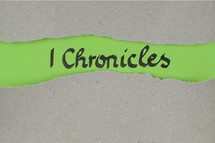 Title 1 Chronicles - torn open kraft paper over green paper with the name of the first book of Chronicles