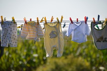 baby clothes drying at a laundry line. 