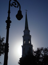 Silhouette of a light post and steeple