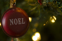 Noel ornament on a Christmas tree