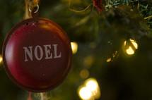 Noel ornament on a Christmas tree