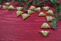 advent cookies on red wood