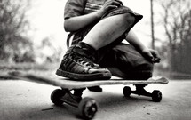 legs on a teen boy on a skateboard