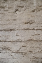 A whitewashed, textured wall. 