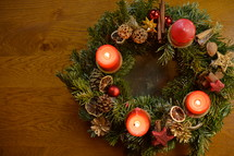 Three candles are burning at the Advent wreath for the third advent sunday