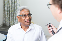 a patient talking with his doctor