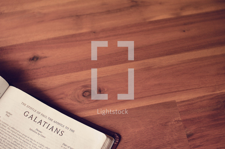 BIble on a wood floor opened to Galatians