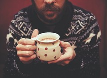 man holding a mug of hot chocolate